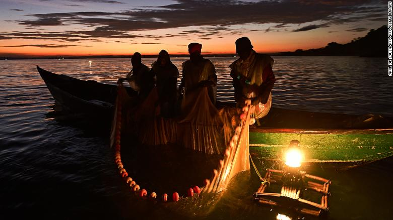 Kenyan fisherman pull up their nets in the early morning as they fish on Lake Victoria.