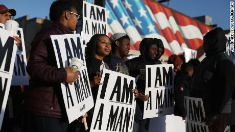MEMPHIS, TN - APRIL 04:  People hold 'I Am A Man' signs, in reference to the sanitation workers strike in 1968, as they participate in an event to mark the 50th anniversary of Dr. Martin Luther King Jr.'s assassination April 4, 2018 in Memphis, Tennessee. American civil rights leader King was killed on April 4, 1968 while supporting a sanitation workers strike in Memphis.  (Photo by Joe Raedle/Getty Images)