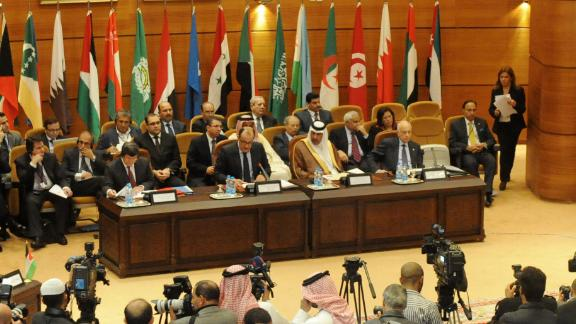 Delegates from Arab League member states and Turkey discuss a response to the government