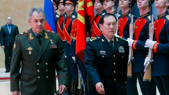 Russian Defense Minister Sergei Shoigu, left, and China's Defense Minister Wei Fenghe review an honour guard prior to their talks in Moscow, Russia, Tuesday, April 3, 2018. Wei emphasized that his visit to Russia is intended to underline close ties between the two nations and their intention to deepen strategic cooperation. (Vadim Savitsky/Russian Defense Ministry Press Service via AP)