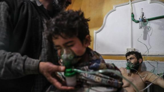 A child receives medical treatment after a village was attacked in the rebel-held Eastern Ghouta region on February 25, 2018. Several people were treated for exposure to chlorine gas, opposition groups said, as airstrikes and artillery fire from the regime continued. CNN was unable to independently verify claims that chlorine was used as a weapon.