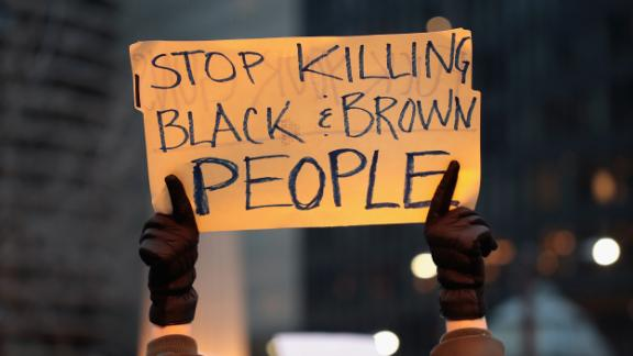 CHICAGO, IL - APRIL 02:  In recognition of the 50th anniversary of the death of Dr. Martin Luther King Jr., and in solidarity with the family and supporters of Stephon Clark and others killed by police, demonstrators protest and march in the Magnificent Mile shopping district on April 2, 2018 in Chicago, Illinois. Dr. King was killed on April 4, 1968.