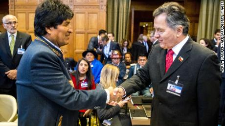 Bolivian president Evo Morales (L) shakes hands with Alfonso Silva (R), Chilean vice-minister of Foreign Affairs, at the ICJ in The Hague on March 19, 2018.  Bolivia and Chile face each other in the International Court of Justice (ICJ) about a border conflict. / AFP PHOTO / ANP / Jerry Lampen / Netherlands OUT        (Photo credit should read JERRY LAMPEN/AFP/Getty Images)