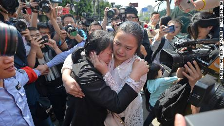 "The wife of Chinese ride-sharing driver Wang Mingqing weeps as she reunites with her missing daughter Kang Ying after 24 years' search in Chengdu city, southwest China's Sichuan province, 3 April 2018.  A couple have reunited with their missing daughter on Tuesday (3 April 2018) following a 24-year long search. Xinhua News Agency reports that Wang Mingqing's 3-year-old daughter disappeared near the family's fruit stand in Chengdu, Sichuan Province, on January 8, 1994, while Wang and his wife were busy at dealing with customers. To aid in their continuing search, in 2014, Wang became a driver for a ride-sharing company in Chengdu, with the hope of branching out his search. Wang would tell his story to his passengers, handing out cards with his daughter's information, hoping to get the message out. The story eventually went national in 2017. Lin Yuhui, a forensic artist in Shandong province, created two sketches of Wang Mingqing's missing daughter in 2017 after he heard of Wang's story. A girl living in the northeastern province of Jilin eventually made contact with Wang Mingqing, after noting the sketches ""surprisingly"" resembled her. A DNA test on 1 April 2018, confirmed that she is Wang's daughter."