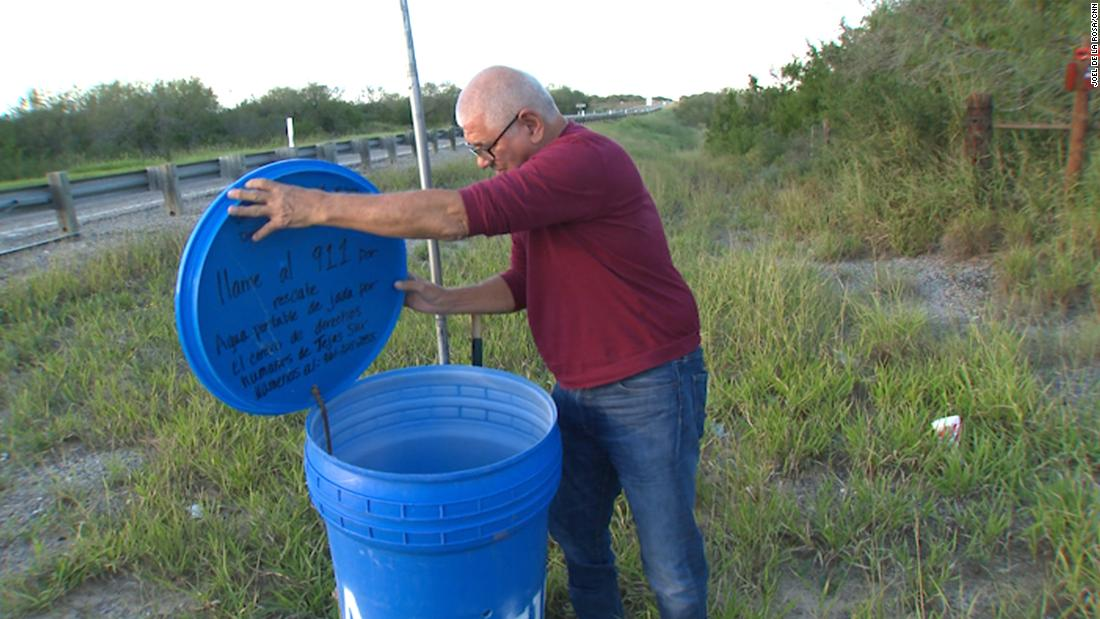 eddie canales director of the south texas human rights center checks a water station
