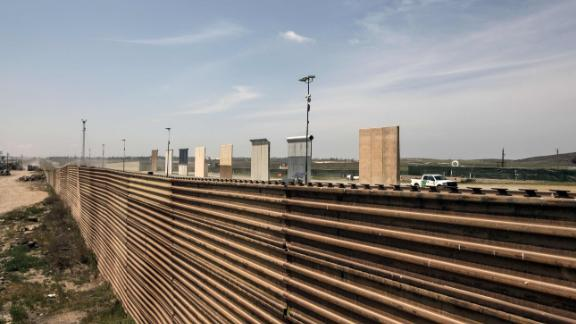 A US border patrol truck is seen next to US President Donald Trump's border wall prototypes from the US-Mexico border in Tijuana, northwestern Mexico, on April 3, 2018. President Donald Trump on Tuesday vowed to deploy the military to secure America's southern border, as a caravan of Central American migrants heads north through Mexico toward the United States. / AFP PHOTO / GUILLERMO ARIAS        (Photo credit should read GUILLERMO ARIAS/AFP/Getty Images)