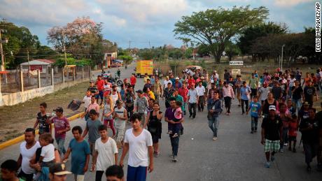 Central American migrants traveling with the annual Stations of the Cross caravan march to call for migrants' rights and protest the policies of U.S. President Donald Trump and Honduran President Juan Orlando Hernandez, in Matias Romero, Oaxaca State, Mexico, Tuesday, April 3, 2018. Bogged down by logistical problems, large numbers of children and fears about people getting sick, the caravan was always meant to draw attention to the plight of migrants and was never equipped to march all the way to the U.S. border.(AP Photo/Felix Marquez)