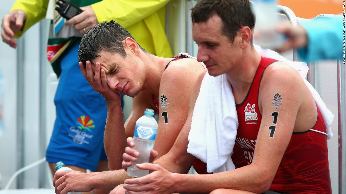 Jonathan Brownlee of England (left) and Alistair Brownlee look dejected after the men's triathlon.
