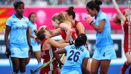 Natasha Marke-Jones of Wales celebrates with Phoebe Richards of Wales and Lisa Daley of Wales after scoring a goal during the Pool A Hockey match between Wales and India.