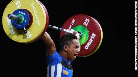 Muhammad Azroy Hazalwafie Izhar Ahmad of Malaysia competes during the weightlifting men's 56kg final.