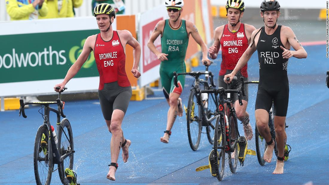Alistair Brownlee (L) and Jonathan Brownlee of England compete with Tayler Reid of New Zealand in the mens triathlon.