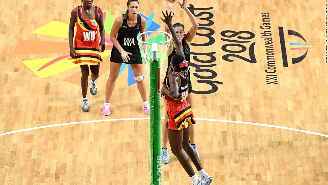 Ameliaranne Ekenasio of New Zealand shoots during the netball match between New Zealand and Uganda.