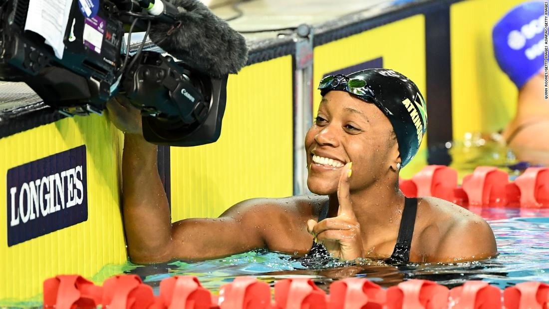 Alia Atkinson of Jamaica smiles following the women's 50m breaststroke semifinal.