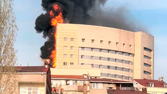 The fire at Taksim Hospital engulfed the facade and forced the evacuation of a number of patients.