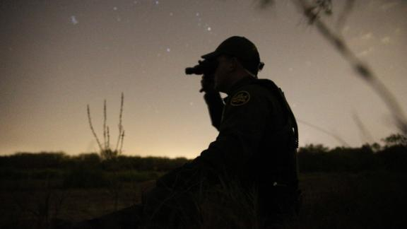 A Border Patrol agent used night vision goggles in April to look for immigrants who illegally crossed from Mexico into the U.S. in the Rio Grande Valley sector in Texas, one of the more dangerous areas for agents.