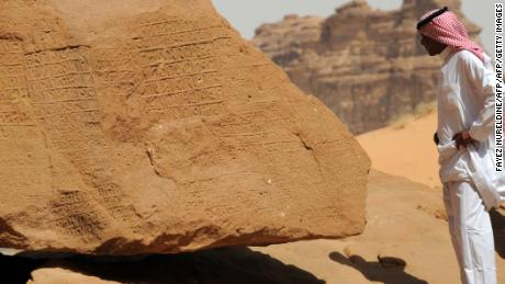 A picture shows inscription on rose-coloured sandstone in the Nabataean archaeological site of al-Hijr near the northwestern town of al-Ula, Saudi Arabia.