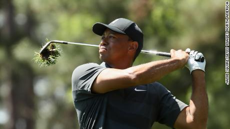 Tiger Woods plays an approach shot to the ninth hole during his first round at the 2018 Masters.