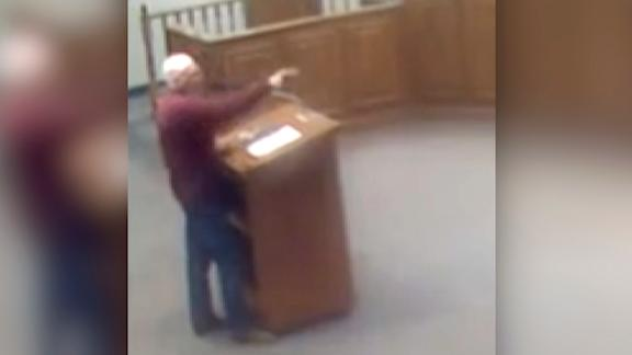 Larry Johnson, a retired politician in Georgia, drops the n-word while talking to a black man during a meeting.