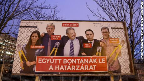 "A Fidesz billboard features Soros among opposition figures and says, ""They would dismantle the border fence together."""