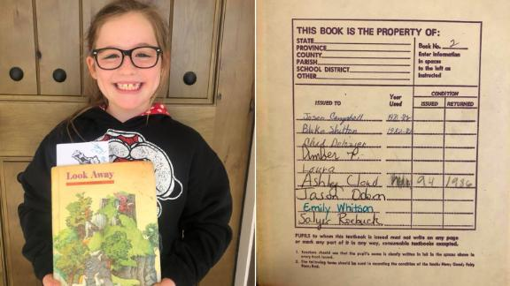 Marley Parker holds a book assigned to her that was used by singer Blake Shelton in 1982.