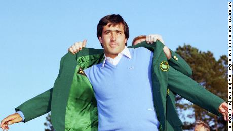 AUGUSTA, GA - APRIL 1983:  Seve Ballesteros puts on the Green Jacket during the 1983 Masters Tournament at Augusta National Golf Club on APRIL 11th, 1983 in Augusta, Georgia. (Photo by Augusta National/Getty Images)