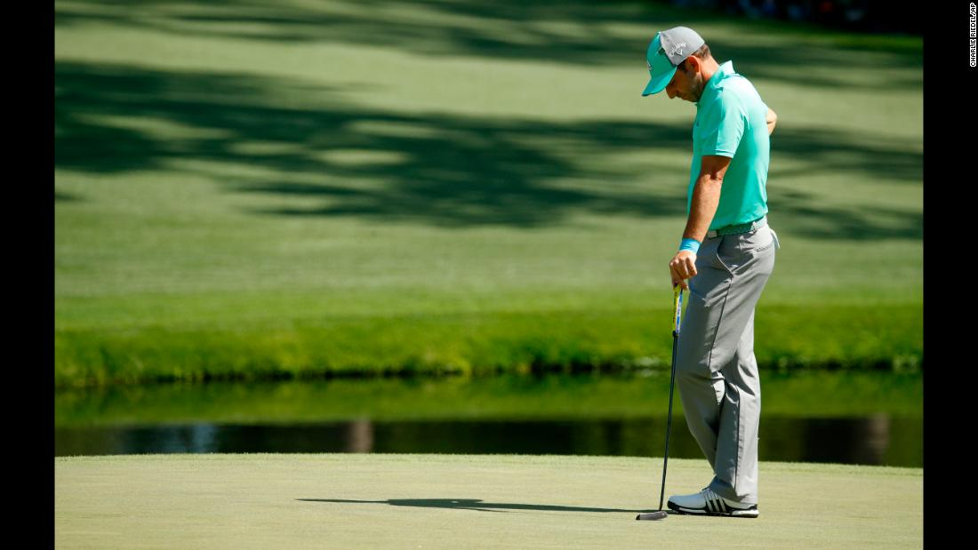 Defending champion Sergio Garcia pauses on the 15th hole, where he hit five shots in the water and made a 13 on Thursday. Its tied for the highest score ever made on one hole of the Masters.