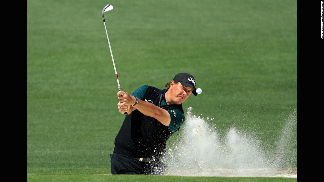 Phil Mickelson plays a shot from the bunker on Thursday.
