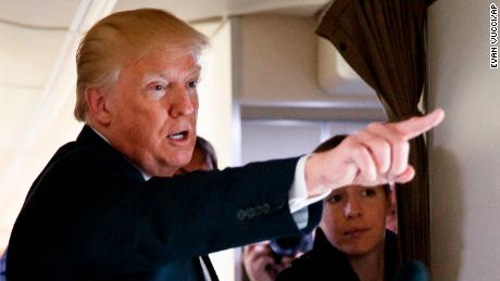 President Donald Trump talks with reporters aboard Air Force One, Thursday, April 5, 2018. (AP Photo/Evan Vucci)