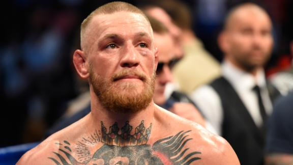 Conor McGregor stands in the ring after being defeated by Floyd Mayweather Jr. by TKO.