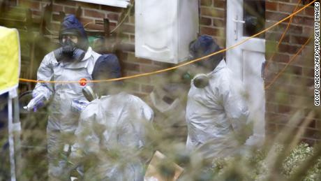 Investigators work in the garden of Sergei Skripal's house in Salisbury on March 22.