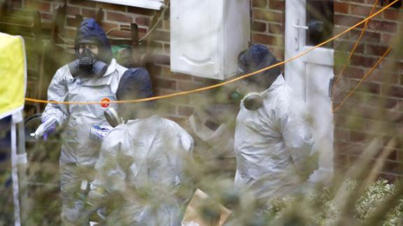 Investigators work in the garden of Sergei Skripal's house on March 22.
