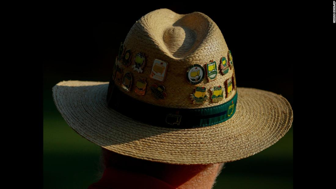 Masters pins adorn a spectator's hat on Friday.