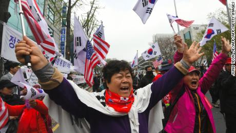 Supporters of South Korea's former president Park Geun-hye gather during a rally demanding her release outside the Seoul Central District Court in Seoul on April 6, 2018.