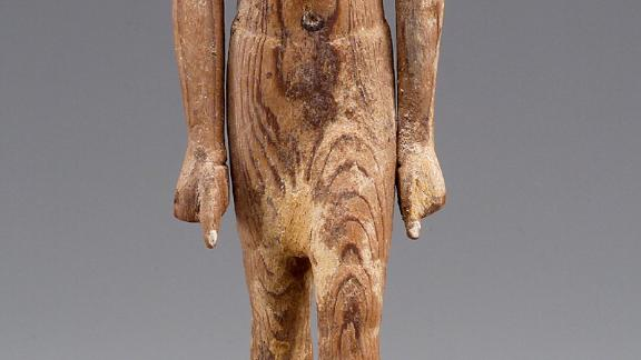Statuettes were found within the tomb. This wooden figure of a striding man is thought to be Governor Djehutynakht.