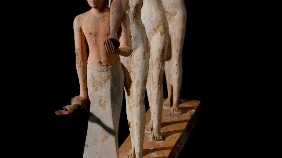 "The best known of the models found within the tomb are the exquisitely carved ""Bersha procession"" of a male priest leading female offering bearers."
