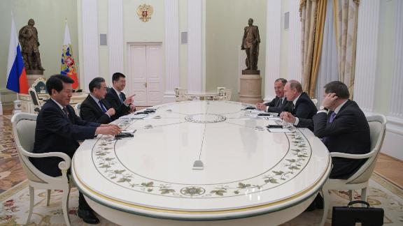 Russian President Vladimir Putin meets with Chinese Foreign Minister Wang Yi at the Kremlin in Moscow on April 5.
