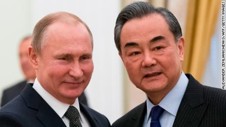 Russian President Vladimir Putin (L) shakes hands with Chinese Foreign Minister Wang Yi during a meeting at the Kremlin in Moscow on April 5, 2018. / AFP PHOTO / POOL / Alexander Zemlianichenko        (Photo credit should read ALEXANDER ZEMLIANICHENKO/AFP/Getty Images)