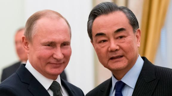 Russian President Vladimir Putin shakes hands with Chinese Foreign Minister Wang Yi during a meeting at the Kremlin in Moscow on April 5.