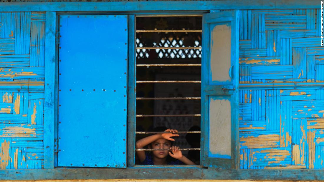 A Rohingya refugee looks out from a school window at Kutupalong refugee camp in Bangladesh's Ukhia district.