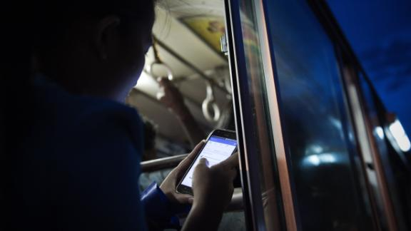 A young woman looks at her Facebook wall while she travels on a bus in Yangon on August 20, 2015. Facebook remains the dominant social network for US Internet users, while Twitter has failed to keep apace with rivals like Instagram and Pinterest, a study showed. AFP PHOTO / Nicolas ASFOURI        (Photo credit should read NICOLAS ASFOURI/AFP/Getty Images)