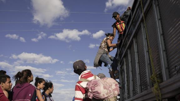 A group of Central American refugees and asylum seekers, led by the non-profit humanitarian organization Pueblos Sin Fronteras (People Without Borders), board a truck offering a ride to their next destination in the town of Santiago Niltepec, Oaxaca state, Mexico, on Saturday, March 31, 2018. The Trump administration is crafting legislation to make it harder for refugees to gain asylum in the U.S. and loosen restrictions on detaining immigrants apprehended near the border, a senior White House official said. Photographer: Jordi Ruiz Cirera/Bloomberg via Getty Images