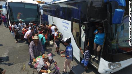 "Central American migrants taking part in the ""Migrant Via Crucis"" caravan towards the United States, arrive in Puebla, Puebla State, Mexico, on April 6, 2018 where they will attend a legal clinic with NGOs on human rights. The caravan of migrants whose trek across Mexico infuriated US President Donald Trump began breaking up on Thursday, after abandoning its plan to travel en masse to the United States. Some headed to Puebla, where the activists who organized the caravan have convened a legal clinic to help them seek asylum or visas, whether in Mexico or the US.  / AFP PHOTO / JOSE CASTAÑARES        (Photo credit should read JOSE CASTANARES/AFP/Getty Images)"