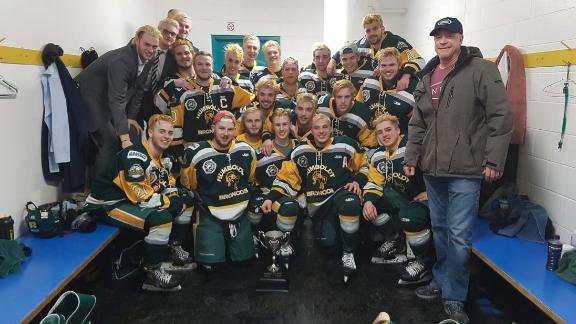 Members of the Humboldt Broncos pose for a photo after winning the Bourgault Cup in March.