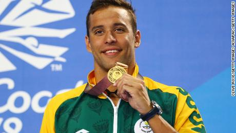 Gold medalist Chad le Clos of South Africa poses during the medal ceremony for the men's 200m butterfly final.