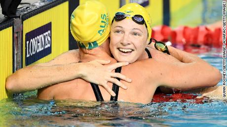 Cate Campbell of Australia (R) celebrates her victory in the women's 50m Freestyle Final with teammate Bronte Campbell.