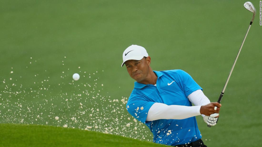 Tiger Woods plays a shot from a bunker on the second hole during the third round of the 2018 Masters Tournament on Saturday, April 7, in Augusta, Georgia.