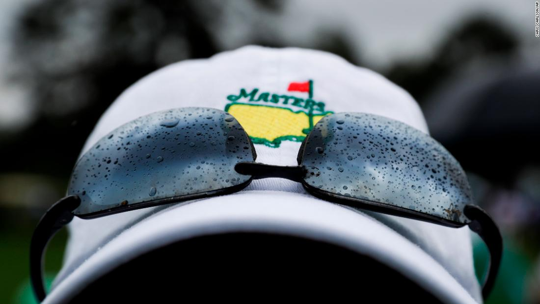 A fan watches from the second hole during the third round at the Masters golf tournament Saturday.