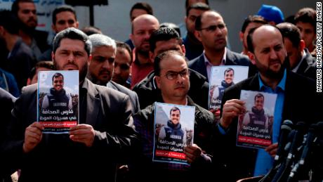 Palestinian journalists carry a portrait of a journalist during his funeral in Gaza City on April 7, 2018. Among those killed at Friday's protest was Yasser Murtaja, a photographer with the Gaza-based Ain Media agency, who died from his wounds after being shot, the local health ministry said.   Murtaja's company confirmed his death, with witnesses saying he was close to the front of the protests in Southern Gaza when he was hit. / AFP PHOTO / MAHMUD HAMS        (Photo credit should read MAHMUD HAMS/AFP/Getty Images)