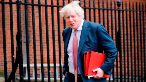 Britain's Foreign Secretary Boris Johnson leaves 10 Downing Street in central London on March 27 after attending the weekly meeting of the Cabinet. / AFP PHOTO / Tolga AKMEN        (Photo credit should read TOLGA AKMEN/AFP/Getty Images)