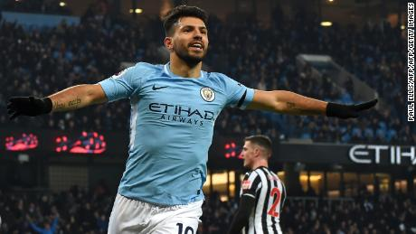Manchester City's Argentine striker Sergio Aguero celebrates scoring against Newcastle United.